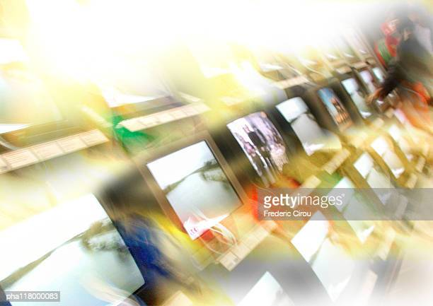 Televisions lined up in store, blurred, tilt