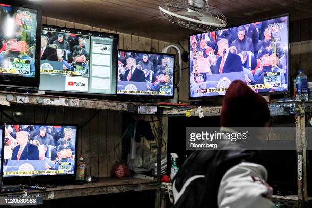 Televisions show a news broadcast of U.S. President Donald Trump in Taipei, Taiwan, on Monday, Jan. 11, 2021. China's state-run media called for...
