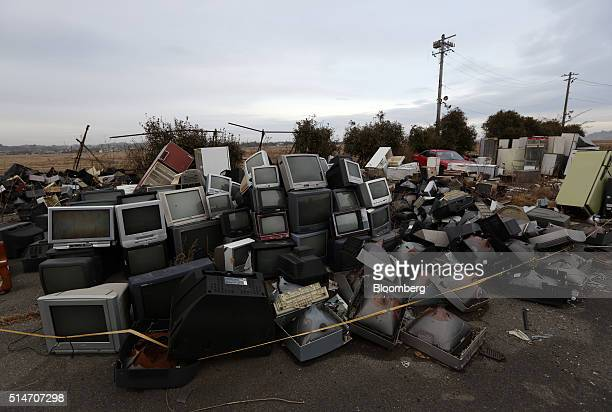 Televisions sit stacked in an evacuation zone area damaged by the 2011 earthquake and tsunami in Minamisoma Fukushima Prefecture Japan on Saturday...