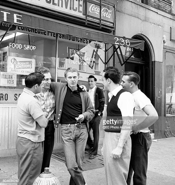 Televisions Wanted Dead or Alive actor Steve McQueen center looking at camera visits his old haunts in Greenwich Village NY Image dated May 6 1960