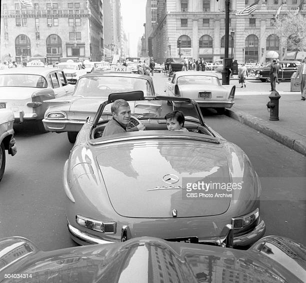 Televisions Wanted Dead or Alive actor Steve McQueen driving his Mercedes Benz 300 SL and his wife Neile Adams visit his old haunts in Greenwich...