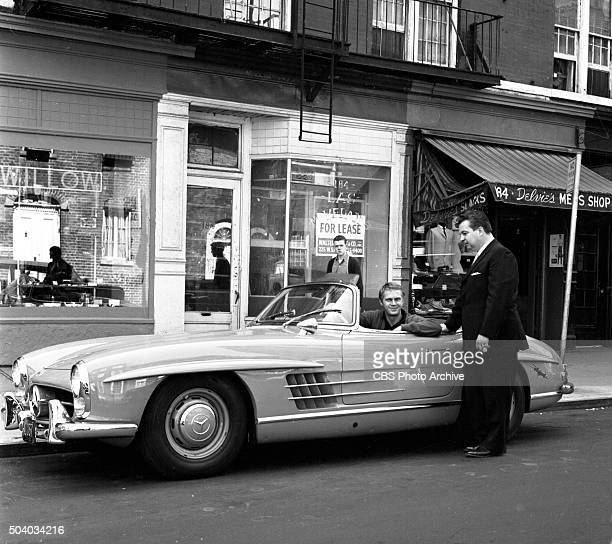 Televisions Wanted Dead or Alive actor Steve McQueen in his Mercedes Benz 300SL visits his old haunts in Greenwich Village NY Image dated May 6 1960