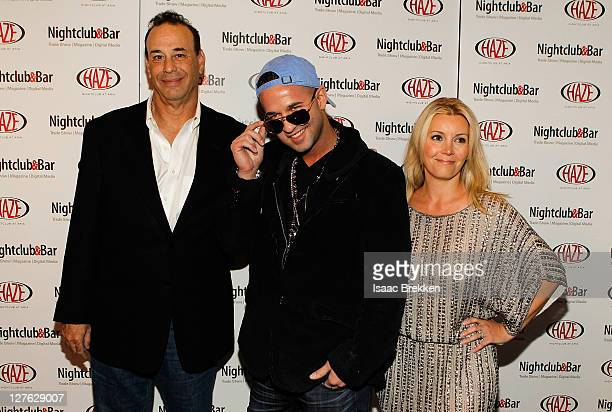Televistion personality Mike 'The Situation' Sorrentino Jon Taffer President Nightclub Bar Media Group and Nicole Taffer arrive at the Nightclub Bar...