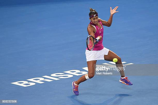 Teliana Pereira of Brazil plays a forehand against Andrea Petkovic of Germany during day one of the 2016 Brisbane International at Pat Rafter Arena...