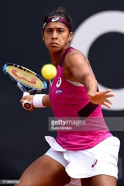 Teliana Pereira of Brazil returns a shot to Petra Martic to Croatia during the Rio Open at Jockey Club Brasileiro on February 15 2016 in Rio de...