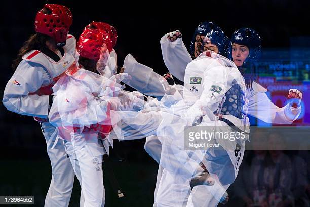 Telisca Reis of Brazil competes with Leandris Quinones of Venezuela during a women's 53 kg of WTF World Taekwondo Championships 2013 at the...