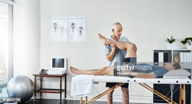 tell me when you start feeling the discomfort - physical therapist stock pictures, royalty-free photos & images