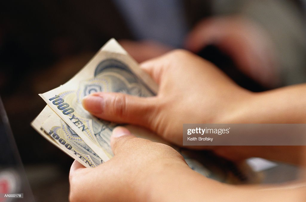 Teller Counting Money at a Currency Exchange : Stock Photo