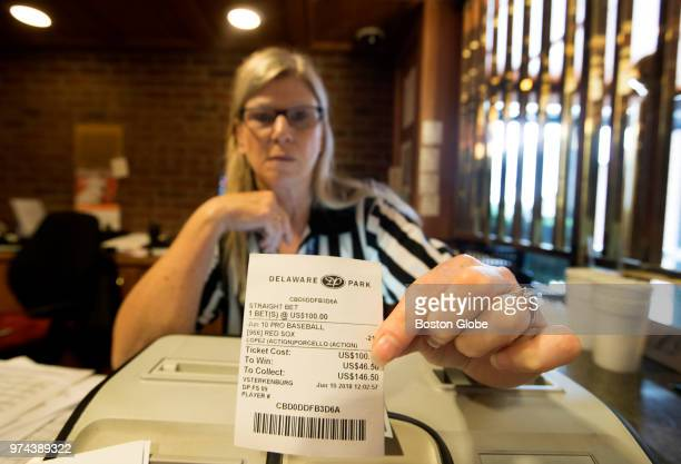 A teller displays a bet on the favored Boston Red Sox to beat the Chicago White Sox at Fenway Park inside Vegas Sports Betting at Delaware Park...