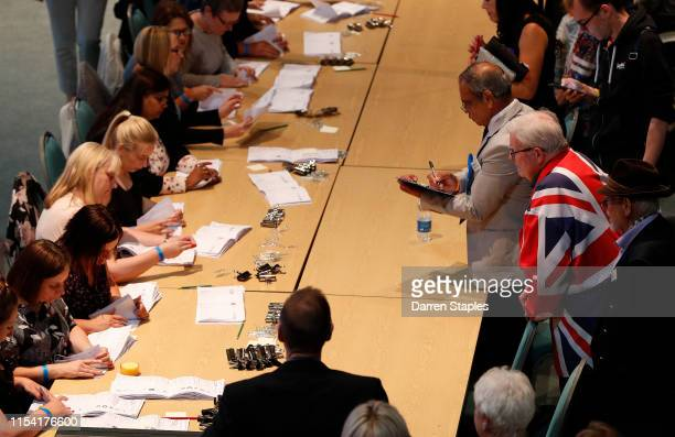Teller in a union flag suit watches ballot papers being sorted at the byelection count centre on June 06 2019 in Peterborough England Brexit Party...