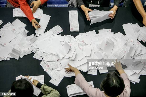 Tellers count votes at a counting center on the presidential election on May 9 2017 in Seoul South Korea Polls have opened in South Korea's...