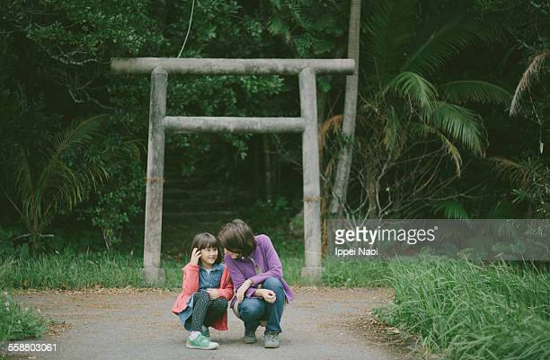 telling secrets in front of a shrine gate, japan - ippei naoi stock pictures, royalty-free photos & images