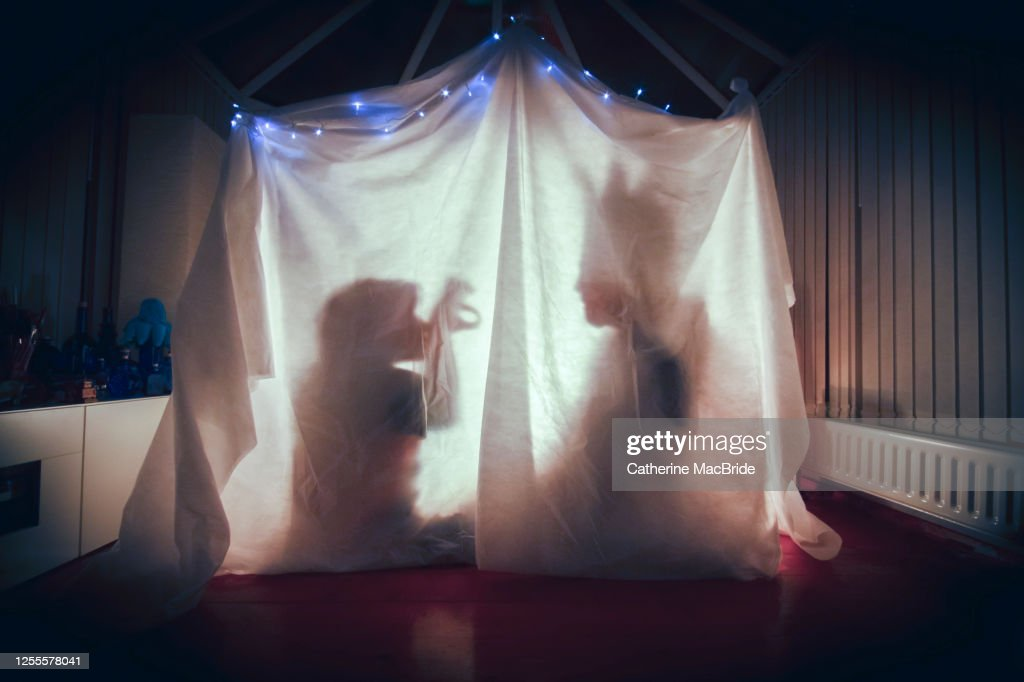 Telling Stories in a home-made Fort : Stock Photo