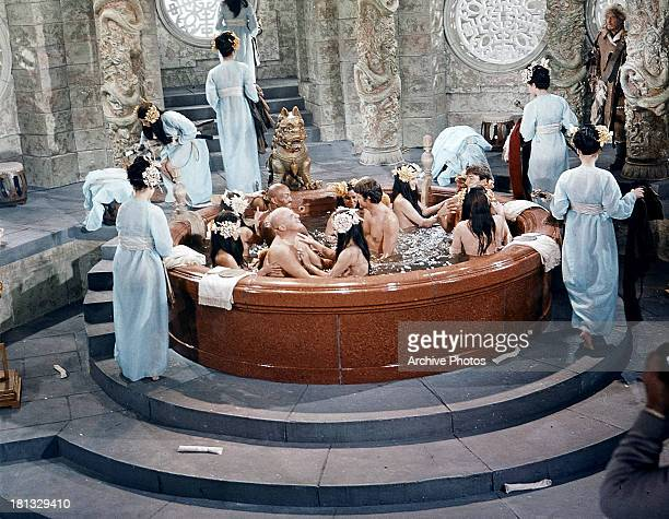 Telly Savalas and others bathe together in a scene from the film 'Genghis Khan' 1965