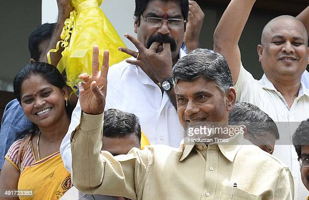 Telugu Desam Party Chief Chandrababu Naidu giving thanks to his supporters during the celebration of party victory in Seemandhra assembly election at...