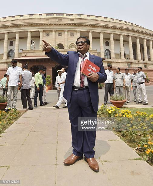 Telugu Desam Party Member of Parliament Naramalli Sivaprasad dressed up as BR Ambedkar demanding special state status for Telangana as he attends the...
