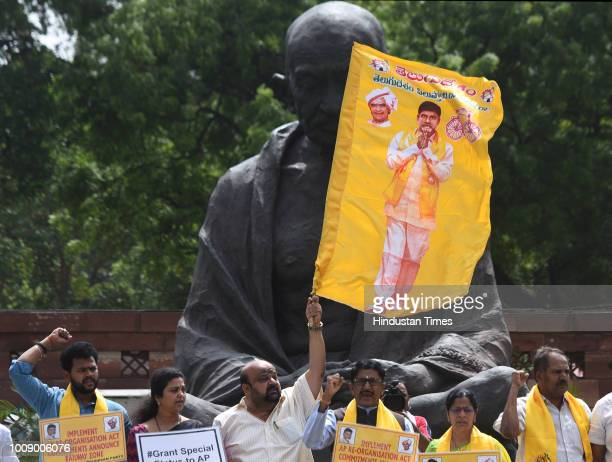 Telugu Desam Party MPs stage a protest demanding special status for Andhra Pradesh during the Monsoon session of Parliament on August 1 2018 in New...