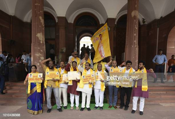 Telugu Desam Party MPs stage a protest for the special status to the state of Andhra Pradesh during the Monsoon session of Parliament on August 2...