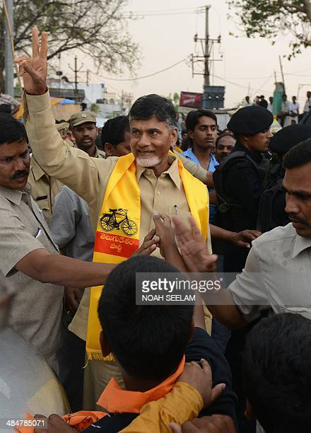 Telugu Desam Party President and former Andhra Pradesh state chief minister N Chandra Babu Naidu greets supporters during an election campaign rally...