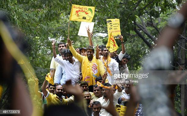 Telugu Desam Party supporters celebrate party victory in Seemandhra assembly election at Bajara hills residence of Telugu Desam Party Chief...