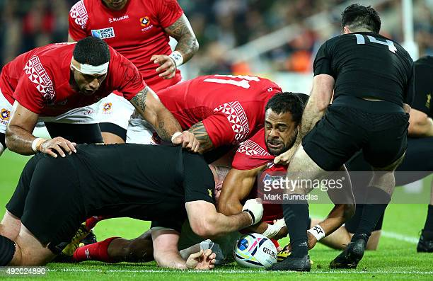 Telusa Veainu of Tonga is pulled off the ball during the 2015 Rugby World Cup Pool C match between New Zealand and Tonga at St James' Park on October...