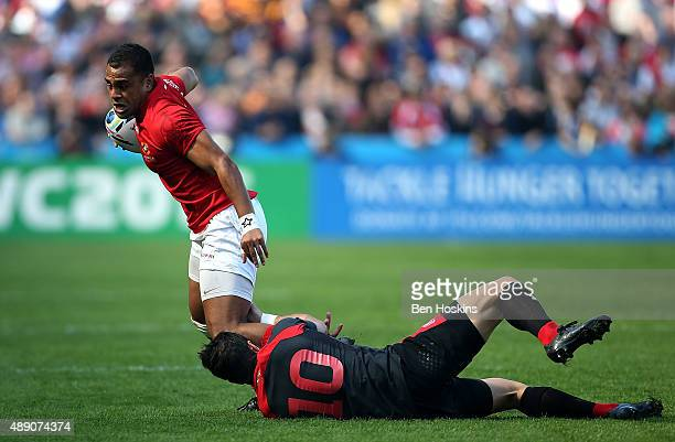 Telusa Veainu of Tonga is tackled by Lasha Malaguradze of Georgia during the 2015 Rugby World Cup Pool C match between Tonga and Georgia at Kingsholm...