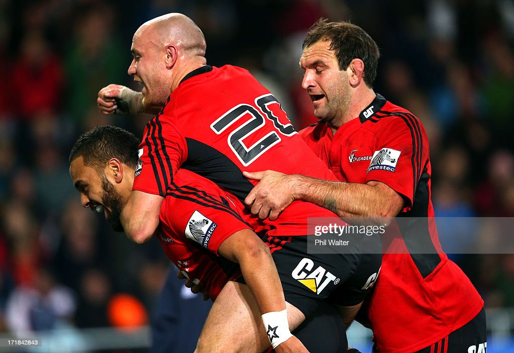 Telusa Vieanu of the Crusaders (L) is congratulated on his try by Willi Heinz and George Whitelock during the round 18 Super Rugby match between the Highlanders and the Crusaders at Forsyth Barr Stadium on June 29, 2013 in Dunedin, New Zealand.