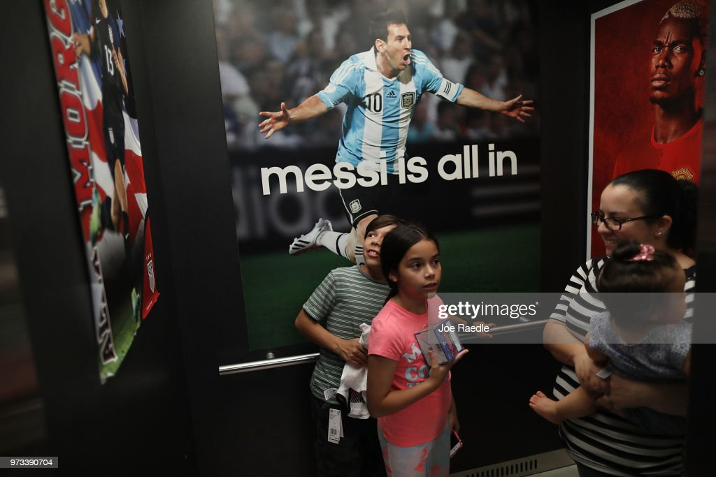Telvia Prego (R) along with her daughter Ava Prego and son David Prego ride in an elevator while shopping at the Soccer Locker store as they prepare to show their support for their favorite World Cup soccer team that is in the tournament being held in Russia on June 13, 2018 in Miami, Florida. As the world prepares for the kickoff of the World Cup soccer tournament tomorrow, FIFA announced today that North America will host the tournament in 2026.