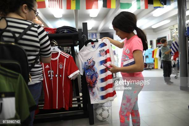 Telvia Prego and daughter Ava Prego shop at the Soccer Locker store as they prepare to show their support for their favorite World Cup soccer team...
