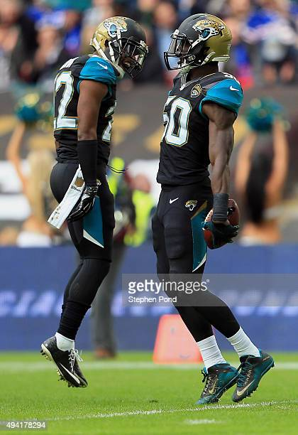 Telvin Smith and Aaron Colvin of the Jacksonville Jaguars celebrate a touchdown in the second quarter during the NFL game between Jacksonville...