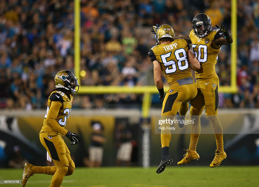 Telvin Smith #50 and Jordie Tripp #58 of the Jacksonville Jaguars celebrate after a play during the first half of the game against the Tennessee Titans at EverBank Field on November 19, 2015 in Jacksonville, Florida.