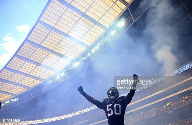 Telvin Smith of Jacksonville makes his way on to the pitch ahead of the NFL International Series match between Indianapolis Colts and Jacksonville...