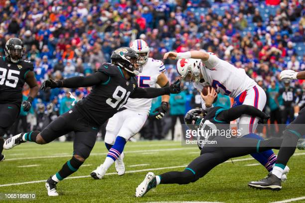 Telvin Smith of the Jacksonville Jaguars brings down Josh Allen of the Buffalo Bills on the team's opening drive in the first quarter at New Era...