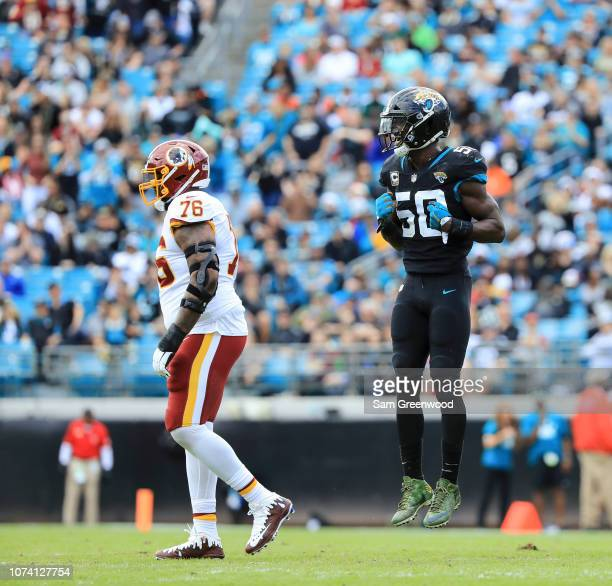 Telvin Smith of the Jacksonville Jaguars celebrates a play while Morgan Moses of the Washington Redskins walks off the field during the first half at...