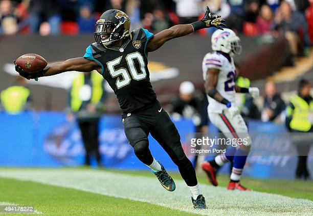 Telvin Smith of the Jacksonville Jaguars celebrates a touchdown during the second quarter of the NFL game against the Buffalo Bills at Wembley...