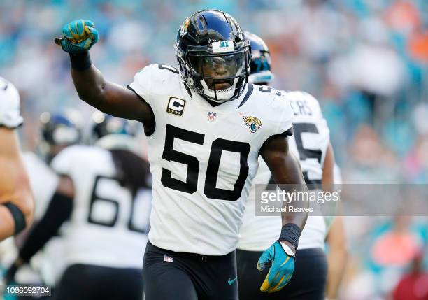 Telvin Smith of the Jacksonville Jaguars celebrates after intercepting a pass for a touchdown in the fourth quarter against the Miami Dolphins at...