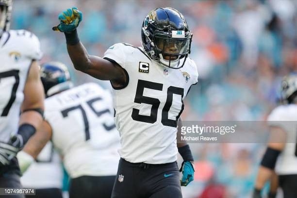 Telvin Smith of the Jacksonville Jaguars celebrates after returning a interception for a touchdown against the Miami Dolphins at Hard Rock Stadium on...