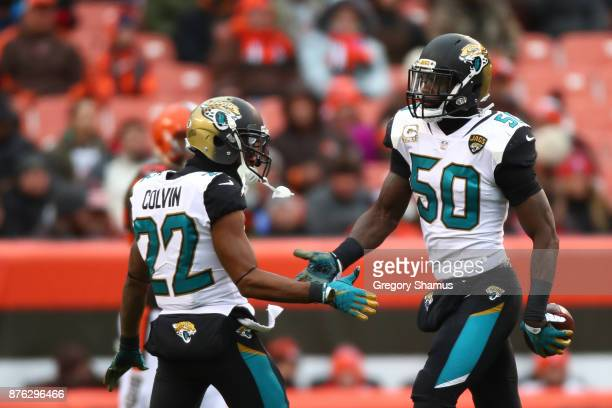 Telvin Smith of the Jacksonville Jaguars celebrates an interception with Aaron Colvin of the Jacksonville Jaguars in the first quarter against the...