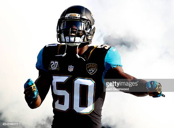 Telvin Smith of the Jacksonville Jaguars enters the stadium before the preseason NFL game against the Atlanta Falcons at EverBank Field on August 28...