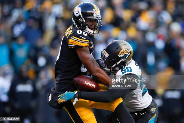 Telvin Smith of the Jacksonville Jaguars hits Darrius HeywardBey of the Pittsburgh Steelers during the second half of the AFC Divisional Playoff game...