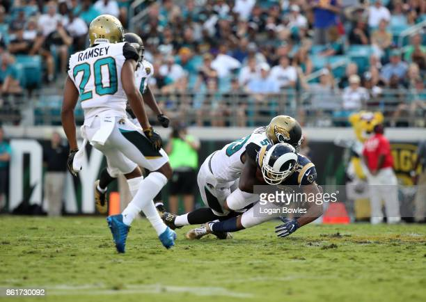 Telvin Smith of the Jacksonville Jaguars makes a play on Robert Woods of the Los Angeles Rams in the second half of their game at EverBank Field on...