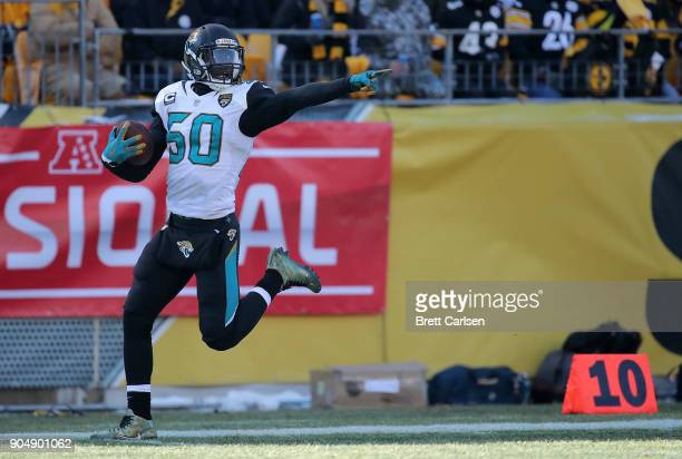 Telvin Smith of the Jacksonville Jaguars reacts after recovering a fumble and returning it for a 50 yard touchdown in the second quarter during the...
