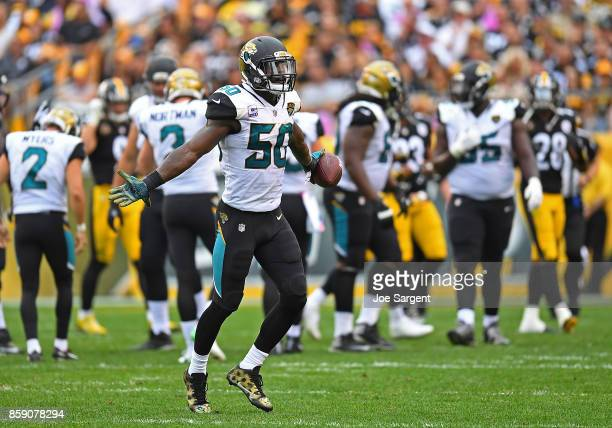 Telvin Smith of the Jacksonville Jaguars reacts after returning an interception 28 yard for a touchdown in the third quarter during the game against...