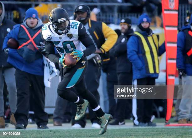 Telvin Smith of the Jacksonville Jaguars recovers a fumble and returns it for a 50 yard touchdown in the second quarter during the AFC Divisional...