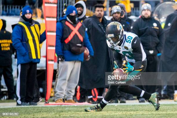 Telvin Smith of the Jacksonville Jaguars runs for a 50 yard touchdown after recovering a fumble by Ben Roethlisberger of the Pittsburgh Steelers...