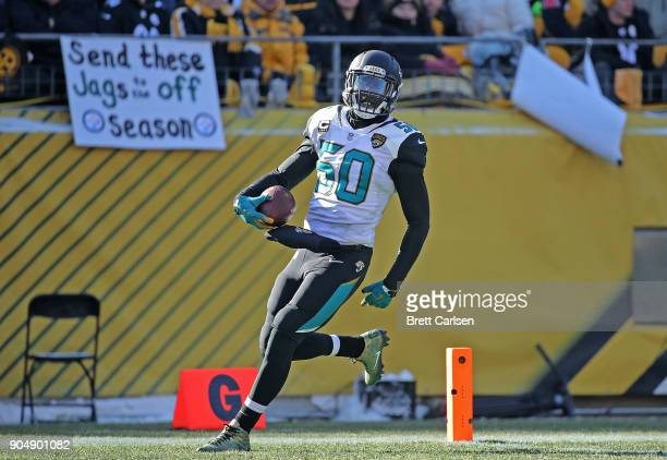 Telvin Smith of the Jacksonville Jaguars runs into the end zone after recovering a fumble and returning it for a 50 yard touchdown in the second...