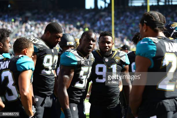 Telvin Smith of the Jacksonville Jaguars speaks turnover his team during their game against the New York Jets at MetLife Stadium on October 1 2017 in...