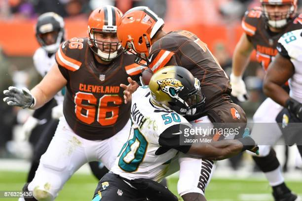 Telvin Smith of the Jacksonville Jaguars tackles DeShone Kizer of the Cleveland Browns in the first half at FirstEnergy Stadium on November 19 2017...