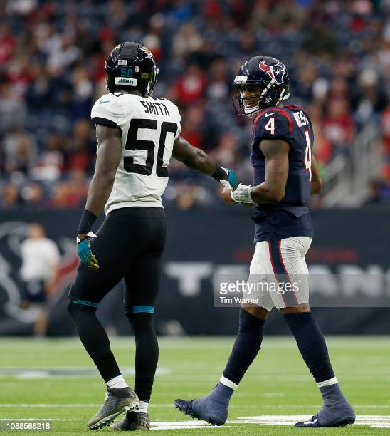 Telvin Smith of the Jacksonville Jaguars talks with Deshaun Watson of the Houston Texans in the fourth quarter at NRG Stadium on December 30 2018 in...