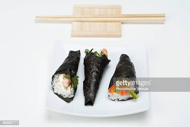 temaki sushi on sushi plate with chopsticks - nori stock pictures, royalty-free photos & images